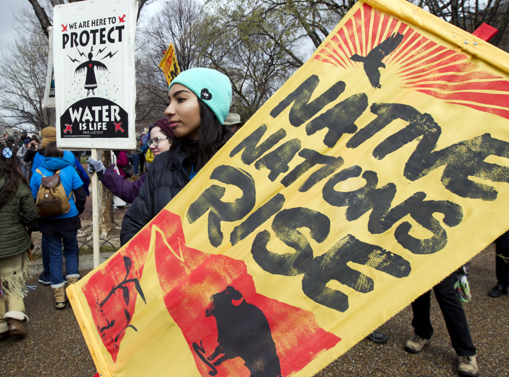 Demonstrators rally outside the White House in March against construction of the disputed Dakota Access pipeline. Some members of Congress think oil pipeline protesters should be labeled domestic terrorists.
