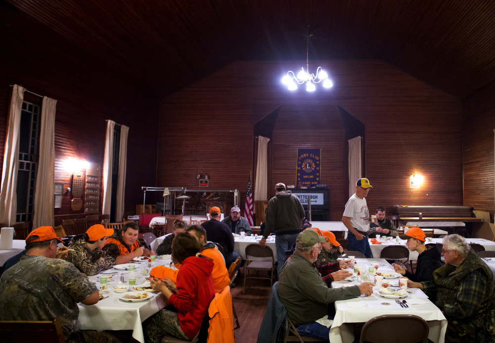 Hunters eat together Saturday before heading to the woods during the hunter's breakfast hosted by the Hartland-St. Albans Lions Club at the Chatterbox Club building in St. Albans. It was the first day of firearms deer season.