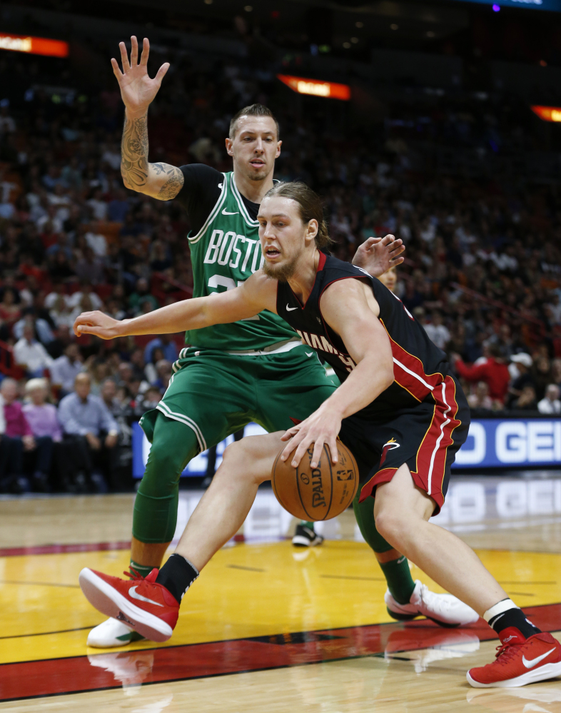 Heat forward Kelly Olynyk drives to the basket against Boston Celtics forward Daniel Theis during the first Saturday in Miami.