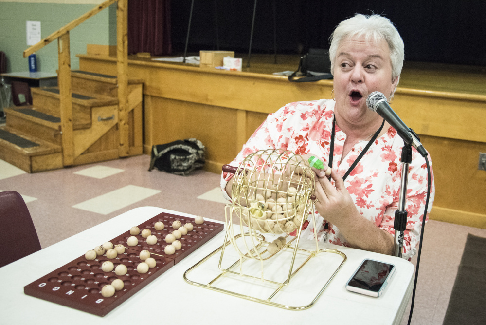 Winslow Elementary School teacher Patty Scully calls out numbers and letters at bingo night at the school Oct. 20. The fundraiser resumed following a change in state law.