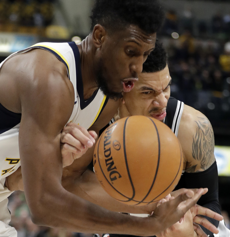 Indiana's Thaddeus Young, left, and San Antonio's Danny Green battle for the ball during the Pacers' 97-94 win Sunday in Indianapolis.