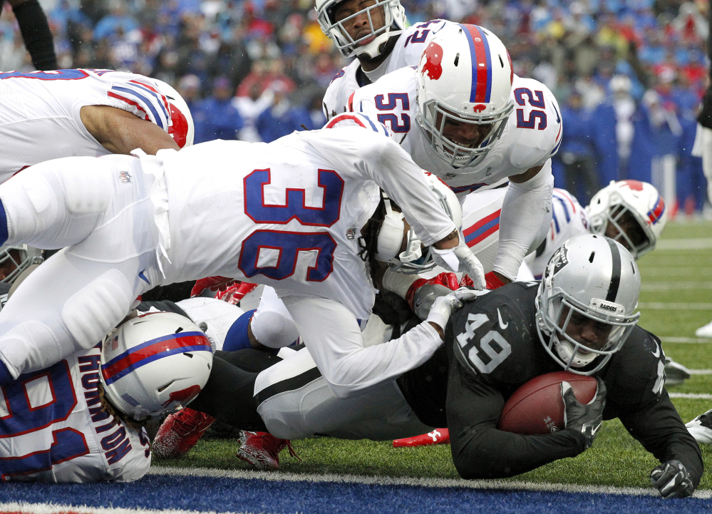 Raiders fullback Jamize Olawale dives into the end zone for a touchdown Sunday, giving Oakland an early lead that didn't last long, as Buffalo earned a 34-14 victory.