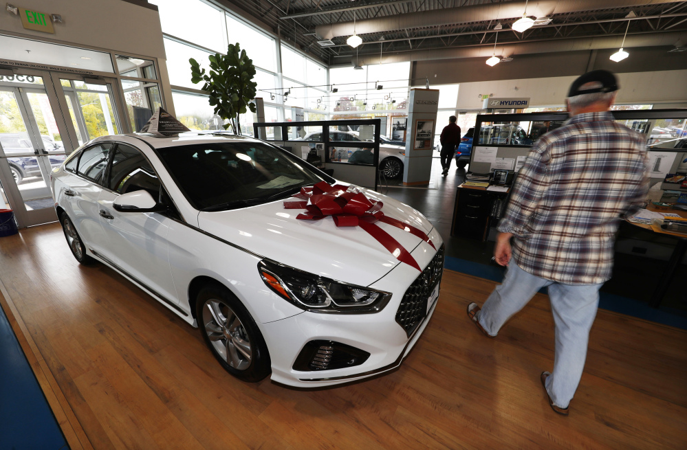 A buyer walks past a 2018 Sonata on the showroom floor of a Hyundai dealership in Littleton, Colo. The Commerce Department on Monday issued its September report on consumer spending, which accounts for roughly 70 percent of U.S. economic activity.