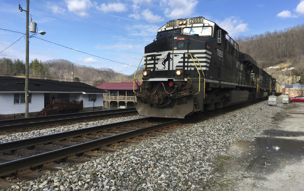A Norfolk Southern coal train runs through Kermit, W.Va. Norfolk Southern Railway must replace millions of defective wooden railroad ties on its tracks because they're degrading faster than expected, the company said in a federal lawsuit filed in Alabama.
