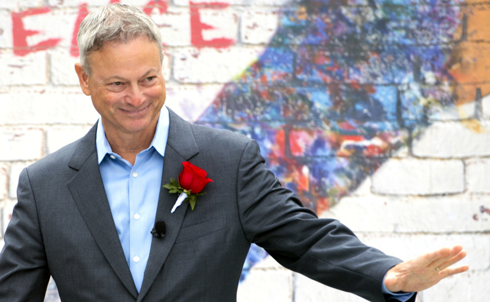 Actor Gary Sinise waves Monday after being named grand marshal of the 2018 Rose Parade. He was chosen for his many contributions to veterans' causes.