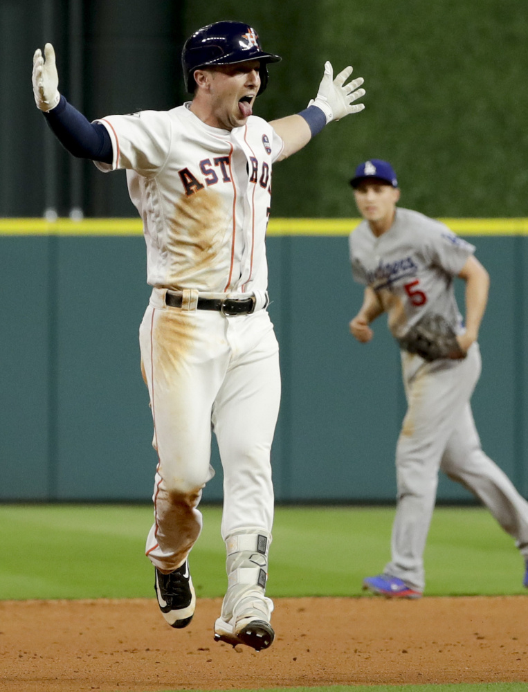 Alex Bregman has a tongue-wagging good time after driving in the winning run in the 10th inning of the Astros' 13-12 win over the Dodgers in Game 5 of the World Series.