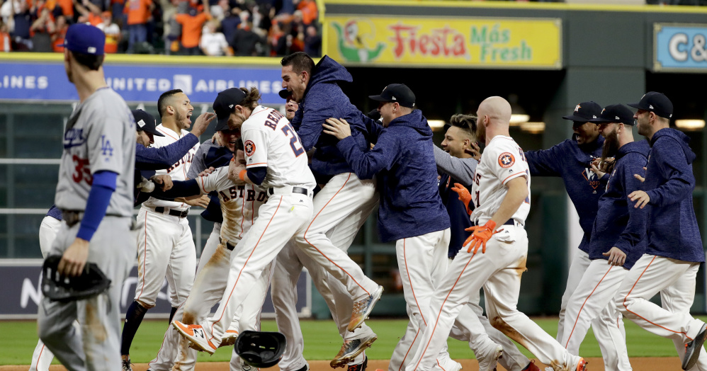 The Houston Astros celebrates after Alex Bregman's game-winning single in Game 5 of the World Series early Monday.