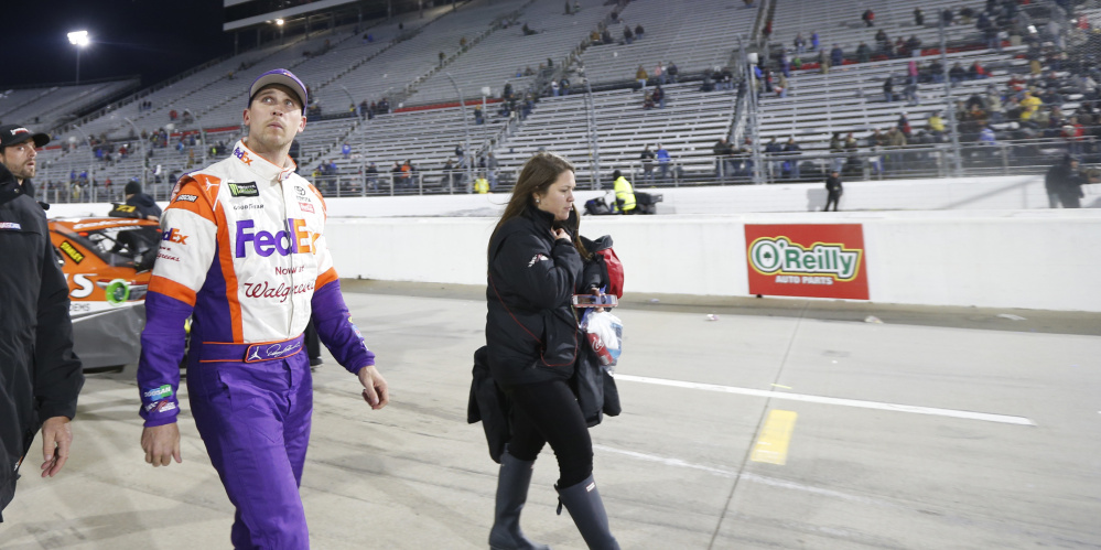 Denny Hamlin leaves the track after the NASCAR Cup series race at Martinsville Speedway in Virginia on Sunday. Hamlin wrecked with Chase Elliott during the last few laps.