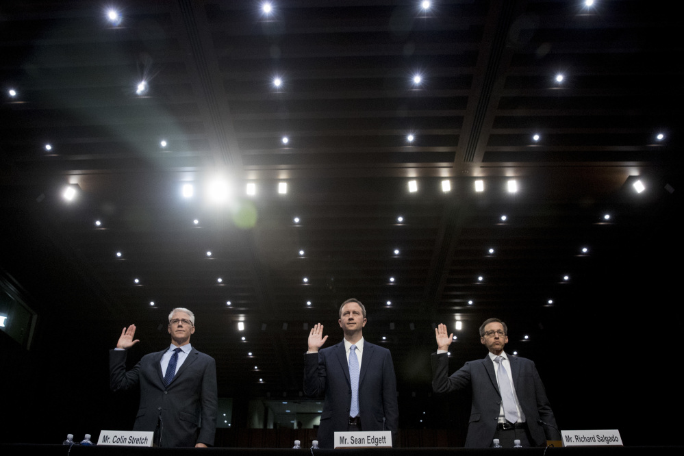 From left, Facebook's General Counsel Colin Stretch, Twitter's Acting General Counsel Sean Edgett, and Google's Law Enforcement and Information Security Director Richard Salgado, are sworn in for a hearing before the Senate subcommittee on crime and terrorism on Capitol Hill in Washington on Tuesday.