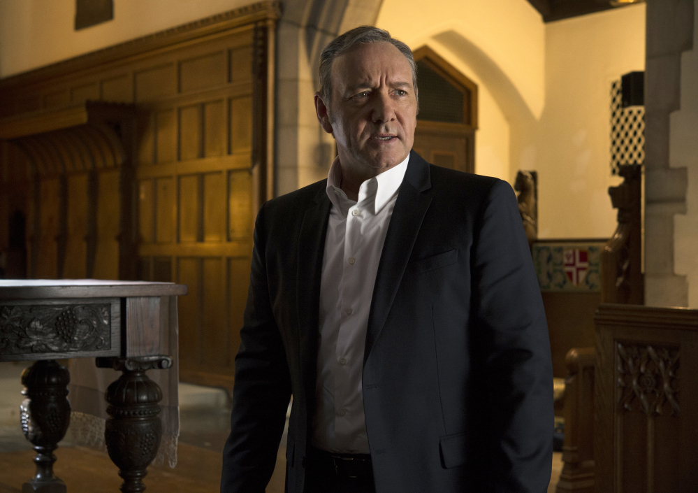 "Kevin Spacey appears in a scene from ""House Of Cards."" Netflix says it's suspending production on ""House of Cards"" following harassment allegations against Spacey."