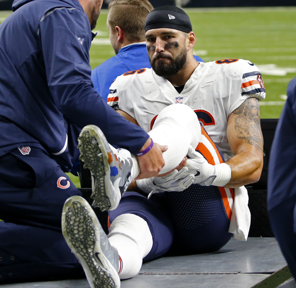 Chicago Bears tight end Zach Miller is taken off the field on a cart after injuring his leg Sunday. Miller dislocated his left knee and suffered popliteal artery damage and needed emergency surgery that might save his leg.