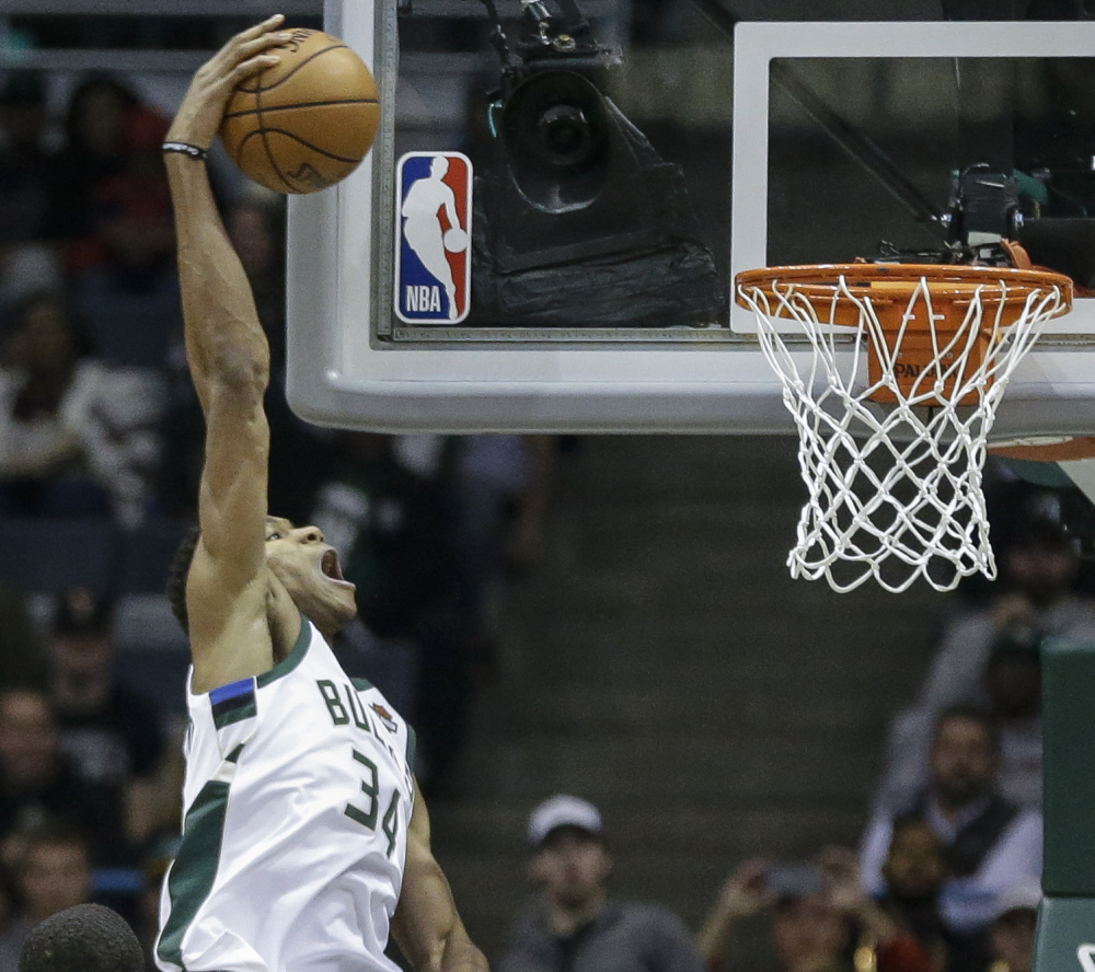 Giannis Antetokounmpo, who scored 28 points Tuesday night for the Milwaukee Bucks, goes up for a dunk during the first half of a 110-91 loss at home to the Oklahoma City Thunder.