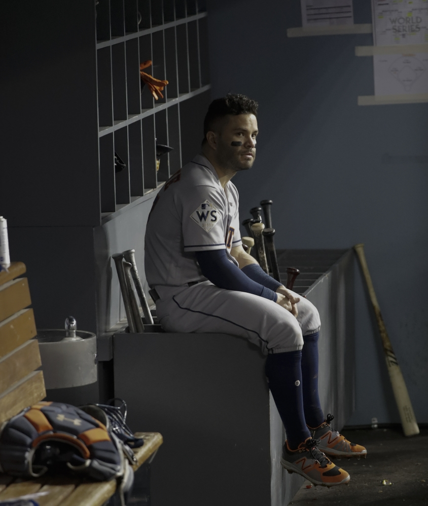 Houston Astros' Jose Altuve watches from the dugout during the eighth inning Tuesday. Associated Press/David J. Phillip