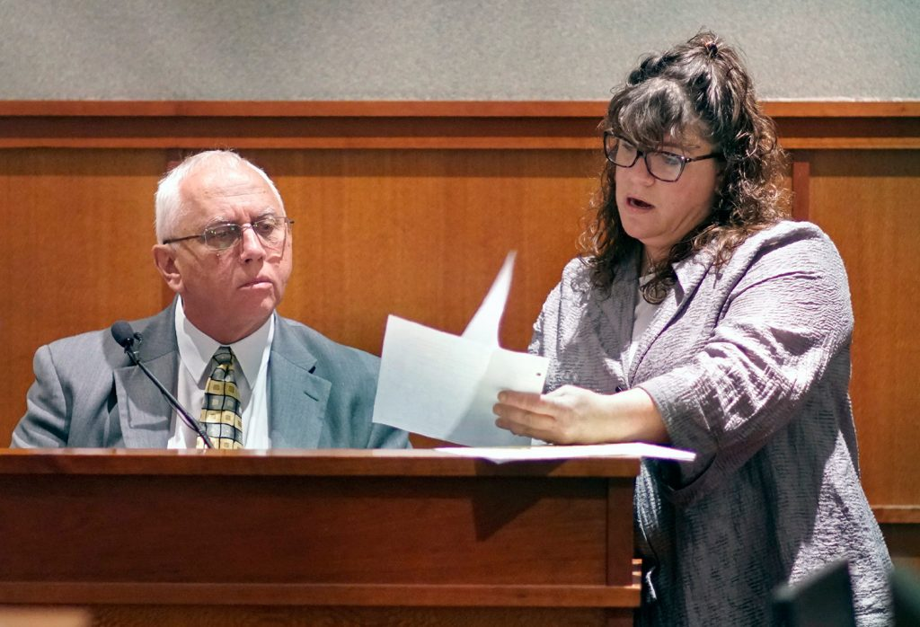 Retired Portland police detective James Daniels reviews a document related to the Jessica Briggs murder investigation with attorney Amy Fairfield on the 12th day of a post-conviction review for Anthony Sanborn Jr. at the Cumberland County Courthouse on Wednesday. Daniels was the lead detective in the investigation into the 1989 murder of Jessica Briggs.