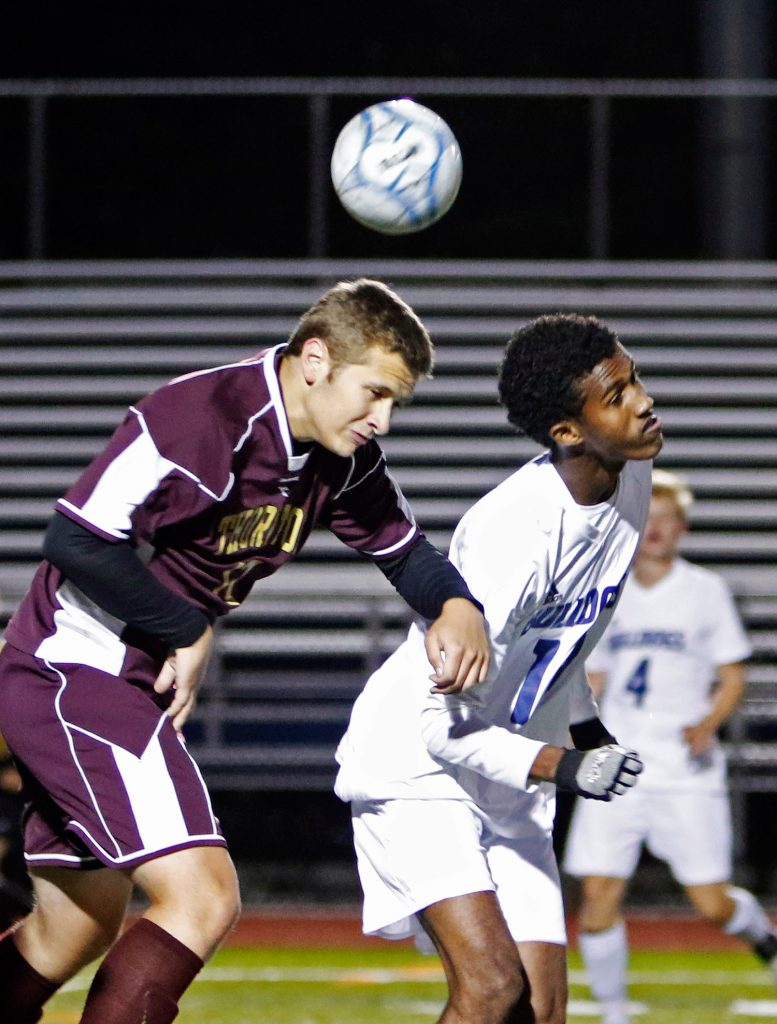 Thornton Academy's Jake Nason and Portland's Sam Nkurunziza go after a ball in the first half of Monday's game.