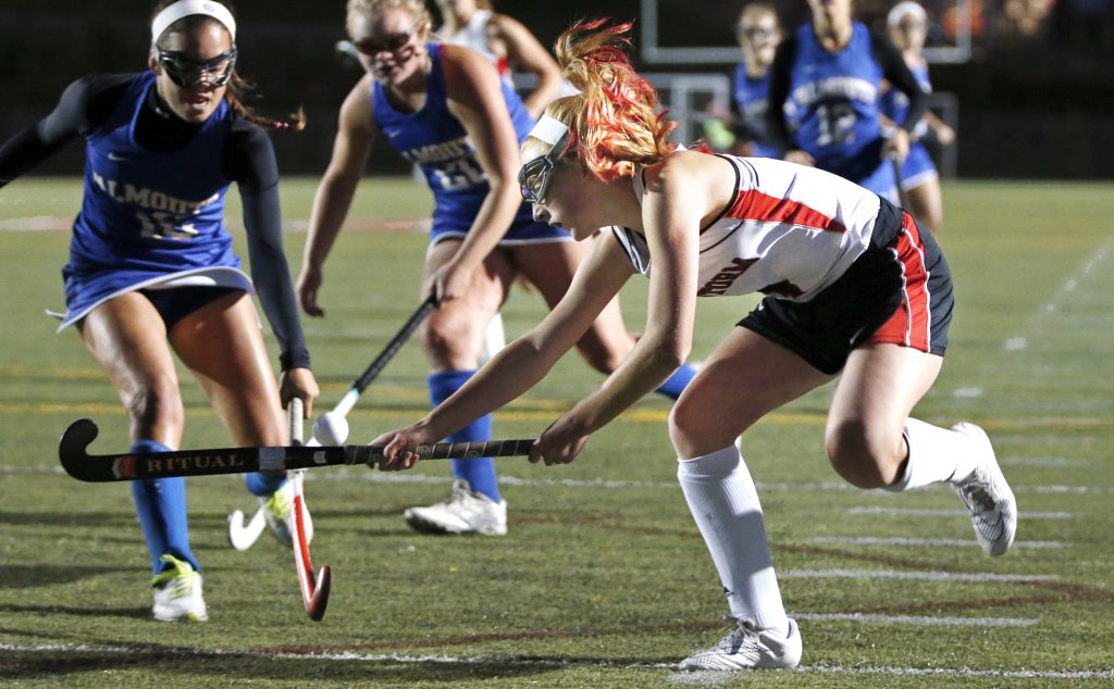 Scarborough forward Carrie Timpson crosses sticks with Falmouth defenders Juliana LaPorta, left, and Caitlin Bull on Tuesday at Scarborough. The Red Storm bested Falmouth, 1-0.