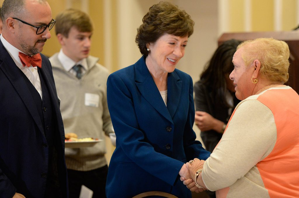 Sen. Susan Collins speaks with people at Friday's Penobscot Bay Regional Chamber of Commerce event.