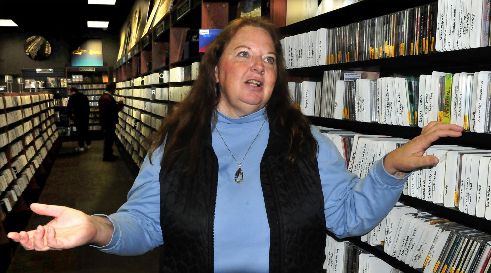 Jennie Patterson, speaking Tuesday at Bull Moose Music in Waterville, talks about about the death of rock musician Tom Petty.