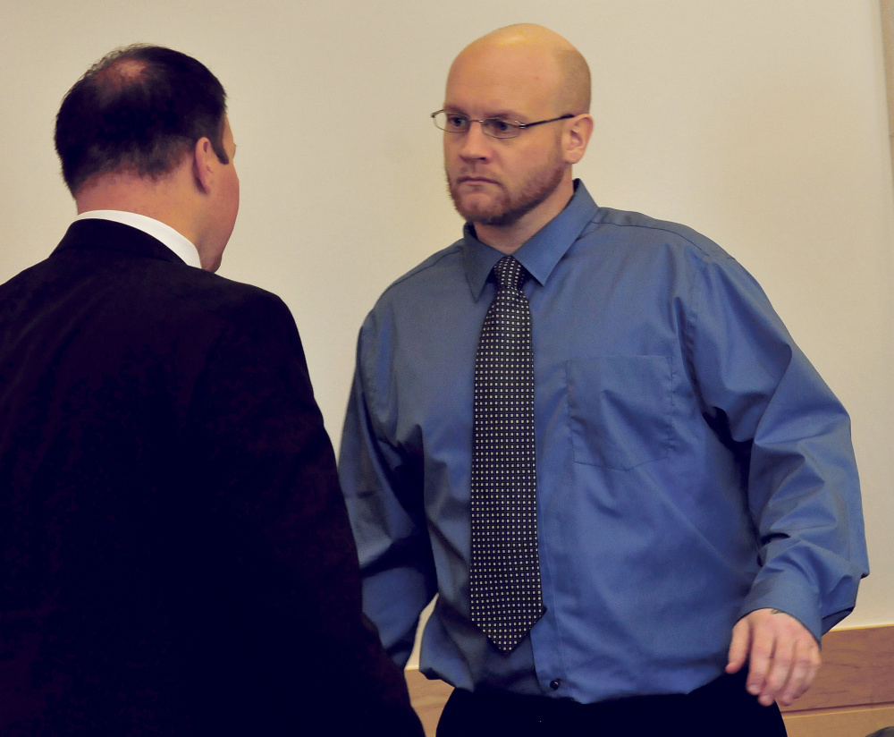 Murder defendant Robert Burton, right, confers with attorney Zachary Brandmeir before closing arguments Wednesday at the Penobscot Judicial Center in Bangor.