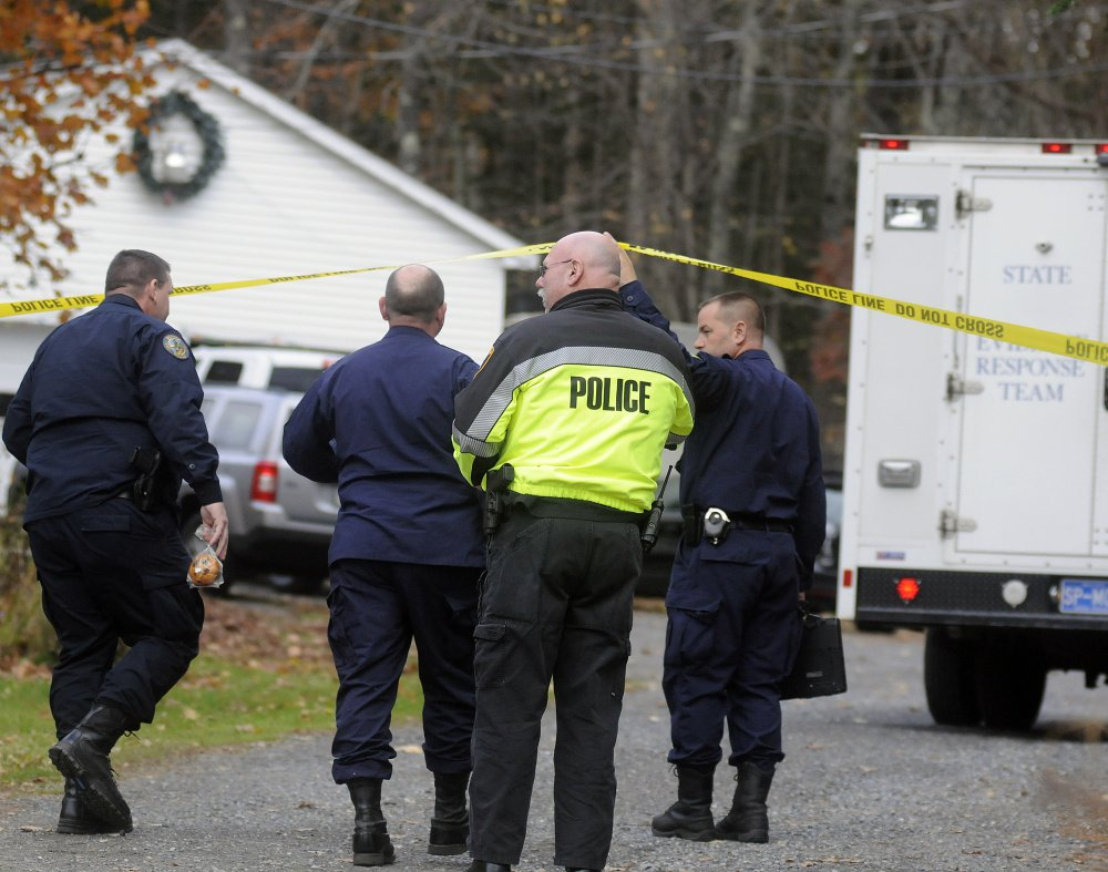 State police detectives enter the driveway of the home in Winthrop where the bodies of Antonio and Alice Balcer were discovered early in the morning on Oct. 31, 2016.
