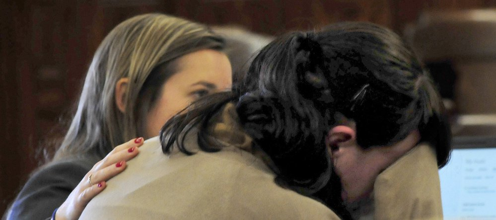 Defendant Miranda Hopkins, of Troy, right, breaks down crying Tuesday while listening to an audiotape of the 911 call to police during her trial in connection with the death of her infant son, Jaxson. Her attorney, Laura Shaw, comforts Hopkins.