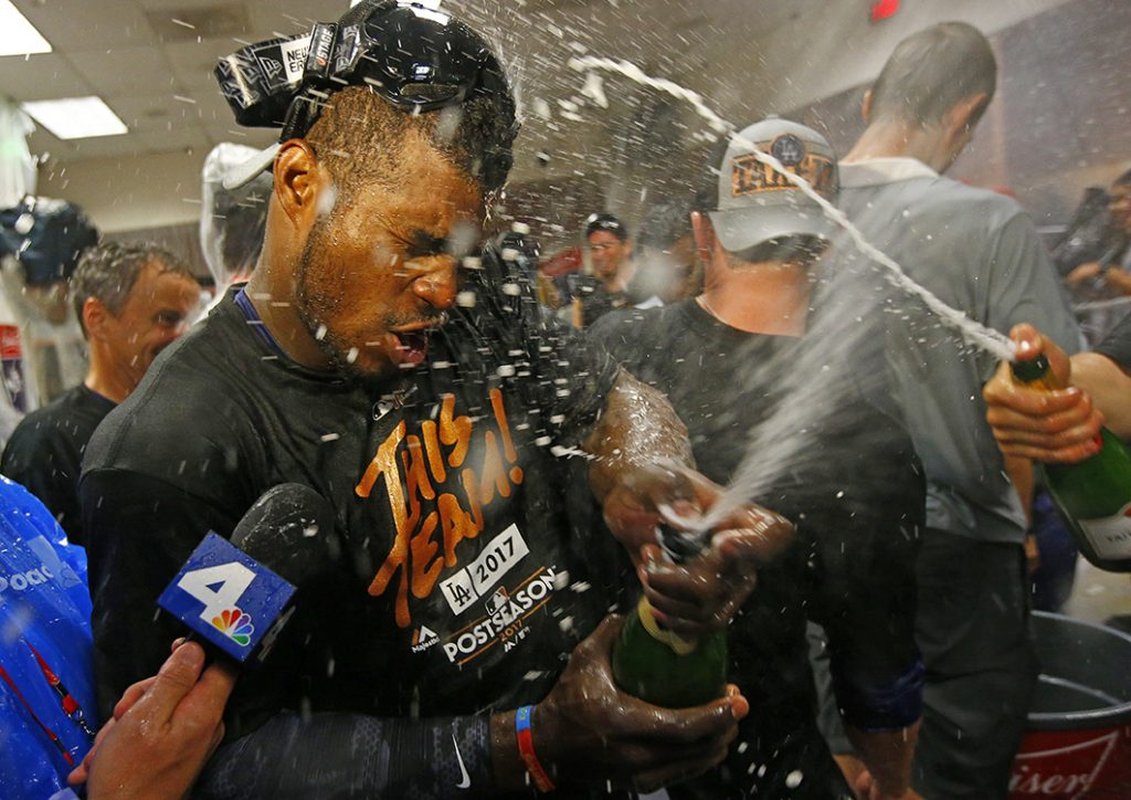 Los Angeles Dodgers' Yasiel Puig celebrates in the clubhouse after game 3 of the National League Division Series against the Arizona Diamondbacks, Monday in Phoenix.