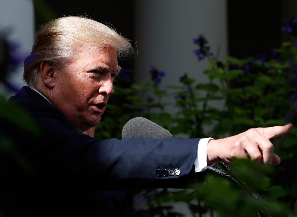 President Trump points to a reporter to take a question Monday at the White House. When asked why he had not spoken about four U.S. soldiers killed in Niger, he suggested that his predecessors fell short in their duty of meeting with the families of military personnel killed in action.