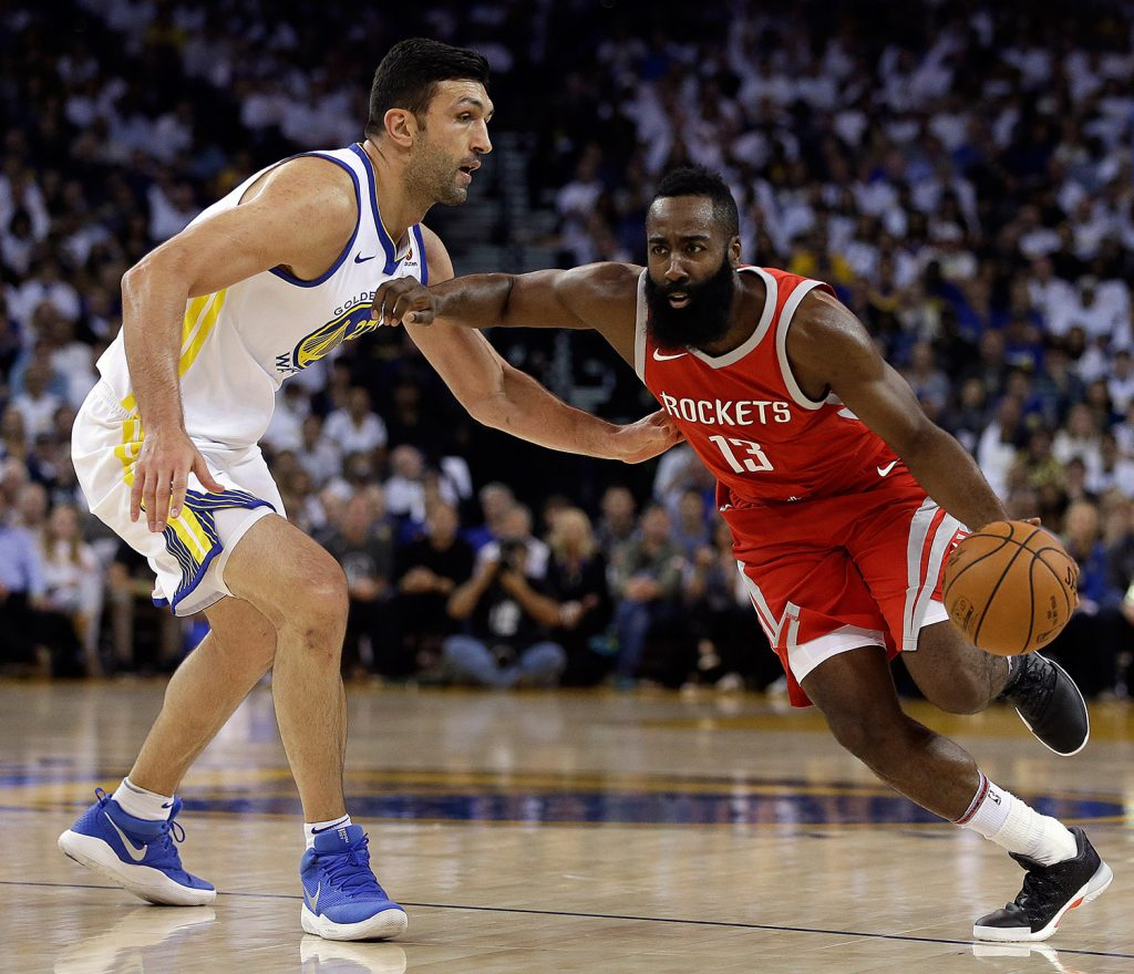 Houston's James Harden, right, drives the ball against Golden State's Zaza Pachulia during the first quarter of an NBA basketball game Tuesday.