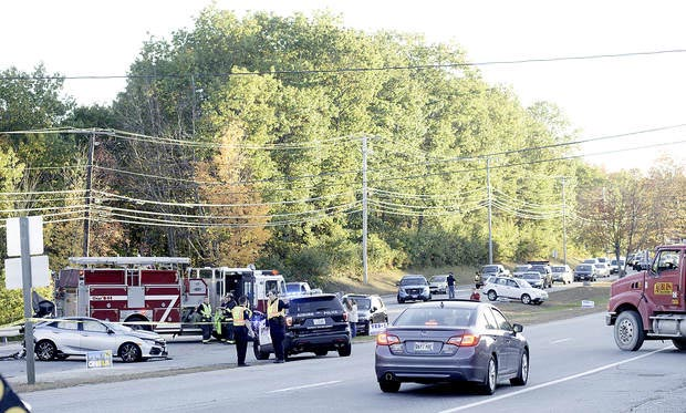 Traffic backs up on the Northbound lane of Washington Street as rescue personnel investigate the fatal accident in Auburn on Tuesday.