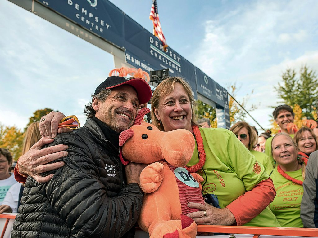 Actor Patrick Dempsey poses with Nina Houghton at the starting line of the Dempsey Challenge, a cancer fundraiser, on Saturday in Lewiston.