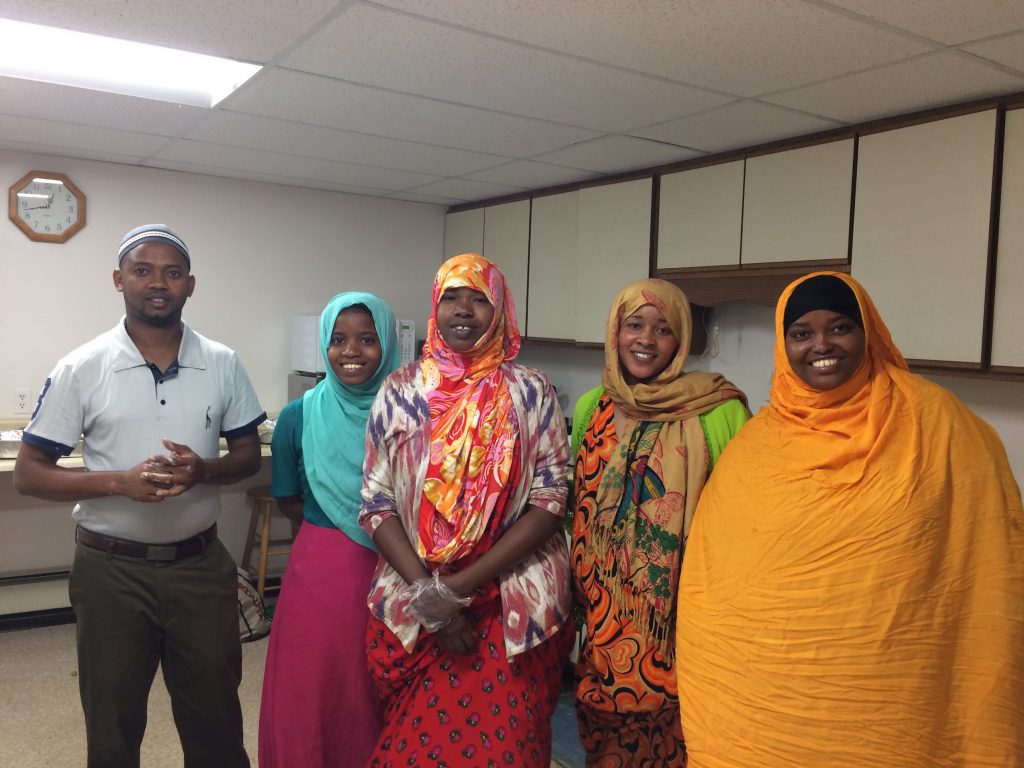 In the kitchen at the Beyond Borders Somali food luncheon, from left:  Mohamed Dekow, Deko Hassan, Asli Hussein, Khadija Noorow and  Khadija Hussein. Dekow is executive director of the Sustainable Livelihoods Relief Organization in Lewiston.