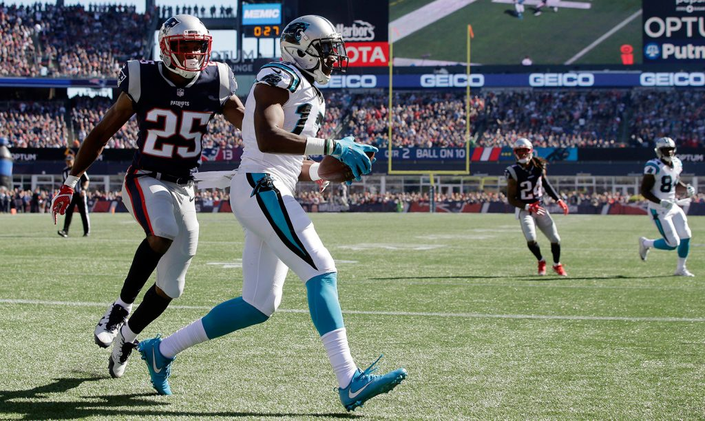 Panthers wide receiver Devin Funchess, catches a touchdown pass in front of Patriots cornerback Eric Rowe in the first half of Sunday's game in Foxborough. New England's porous defense threatens to make this season a big disappointment.