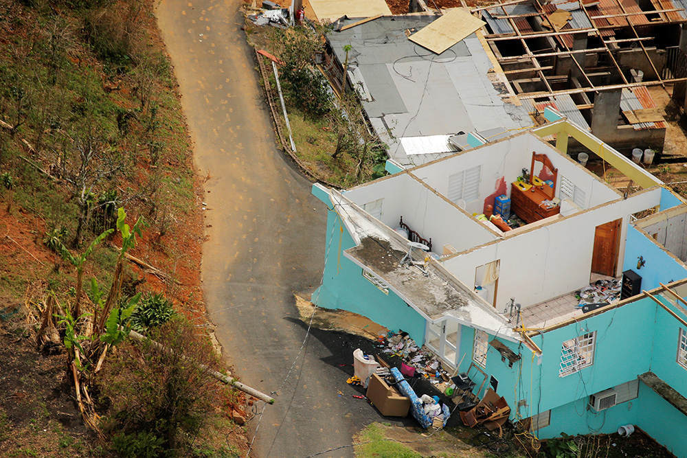 The interior contents of a home are seen from the air during recovery efforts following Hurricane Maria near Utuado, Puerto Rico, on Tuesday.