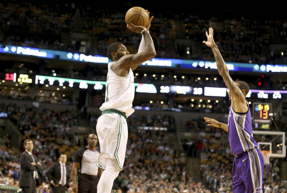 Boston's Kyrie Irving shoots over Sacramento's George Hill in the first half Wednesday night in Boston.