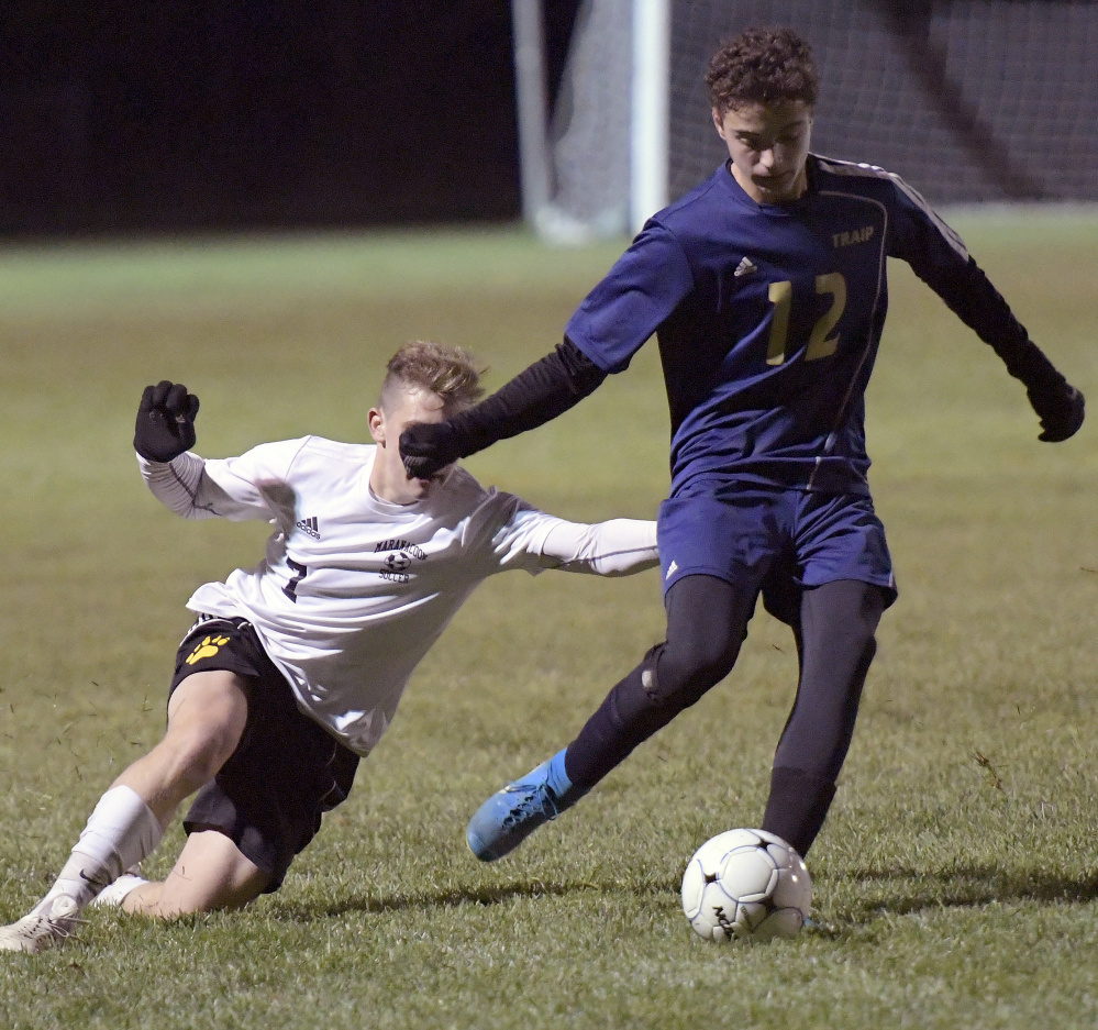 Maranacook's Mitchell Root, left, tries to defend Traip Academy's Ryan Perkins during the Class C South championship game Wednesday in Readfield. The Black Bears won 3-0 to move on to the state final.