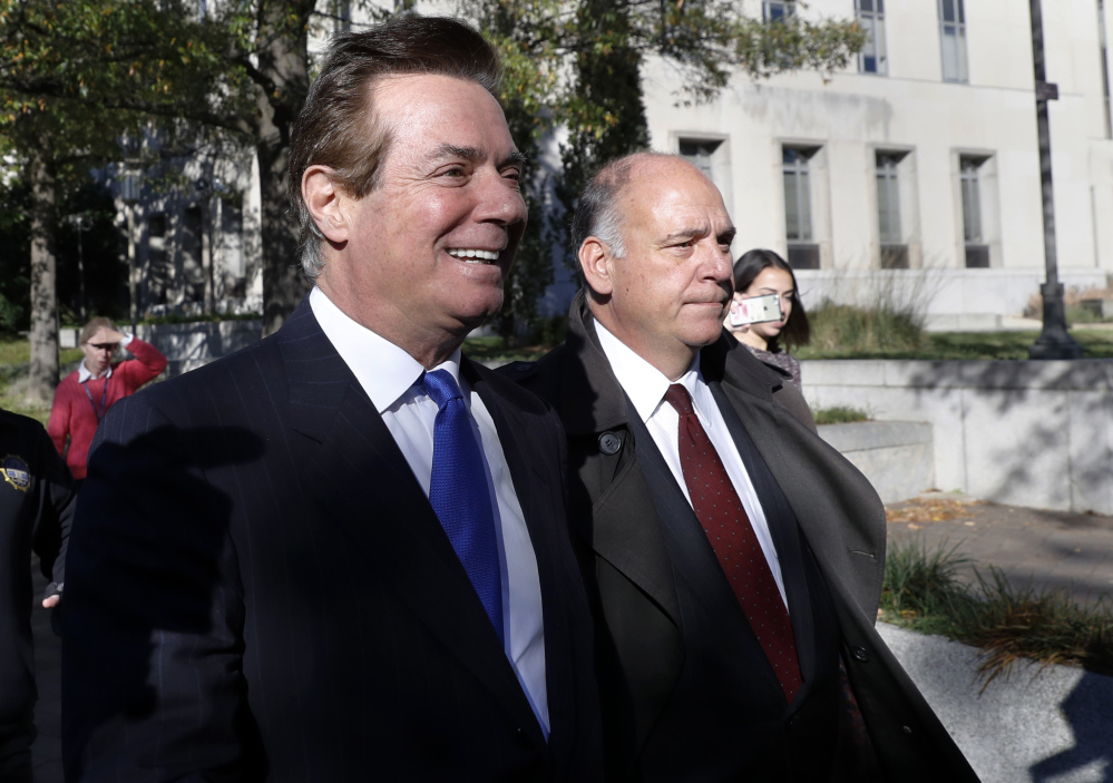 Paul Manafort, left, leaves Federal District Court in Washington on Monday. Manafort, President Trump's former campaign chairman, and Manafort's business associate Rick Gates pleaded not guilty to felony charges of conspiracy against the United States and other counts.