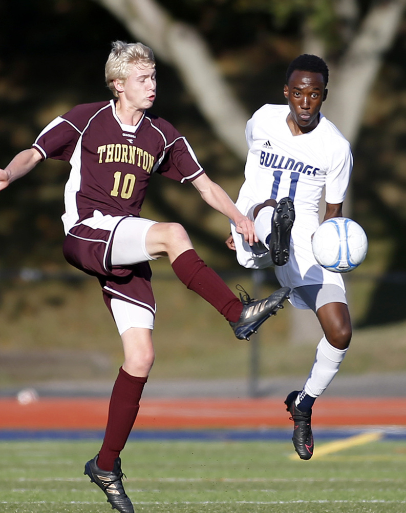 Samuel Nkurunziza of Portland, right, has come up with some clutch goals this season, one of them coming in the 2-1 win over Thornton Academy in the Class A South championship game.