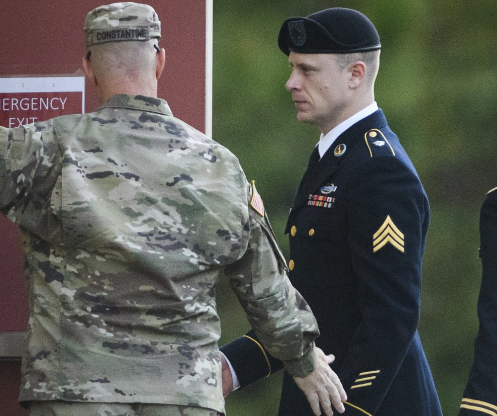 A tense Sgt. Bowe Bergdahl, right, arrives Friday at the Fort Bragg, N.C., courtroom facility after pleading guilty last month to desertion.