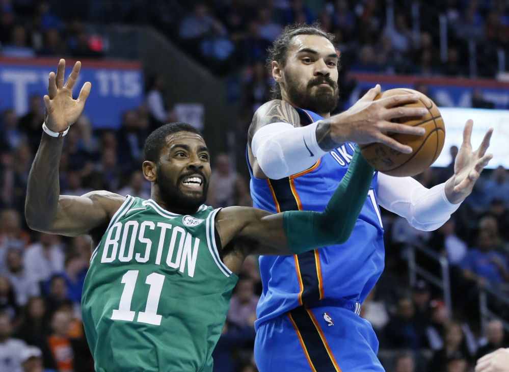 Oklahoma City's Steven Adams grabs a rebound in front of Boston's Kyrie Irving in the first quarter of Friday night's game at Oklahoma City.
