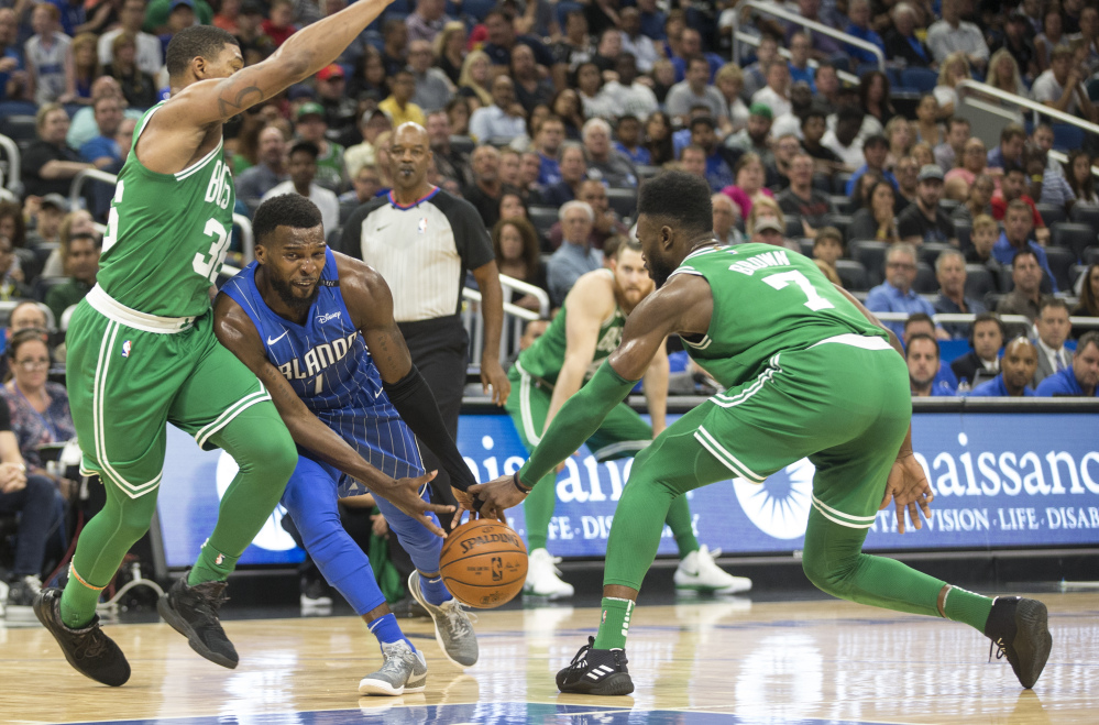 Orlando guard Shelvin Mack has the ball stolen by Celtics guard Jaylen Brown, right, as Boston's Marcus Smart also defends him during the Celtics' 104-88 win Sunday in Orlando, Florida.
