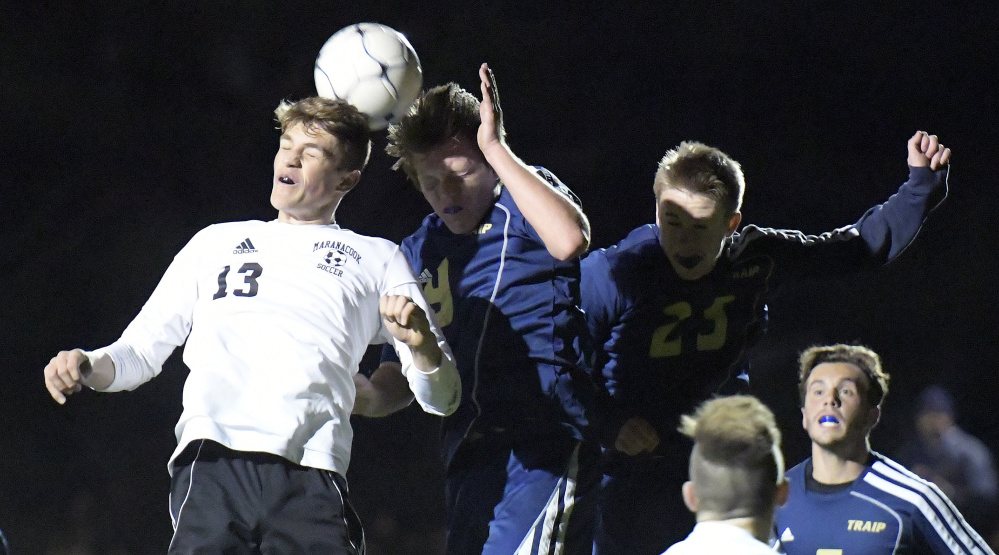 Maranacook senior midfielder Silas Mohlar, left, goes head-to-head with Traip defenders during the Class C South championship game last Wednesday at Ricky Gibson Field of Dreams in Readfield.