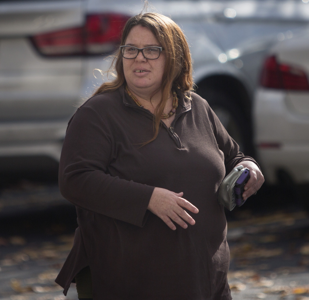 Hope Cady of Augusta walks to the Cumberland County Courthouse in Portland before taking the stand Tuesday in Anthony Sanborn's murder conviction review hearing.