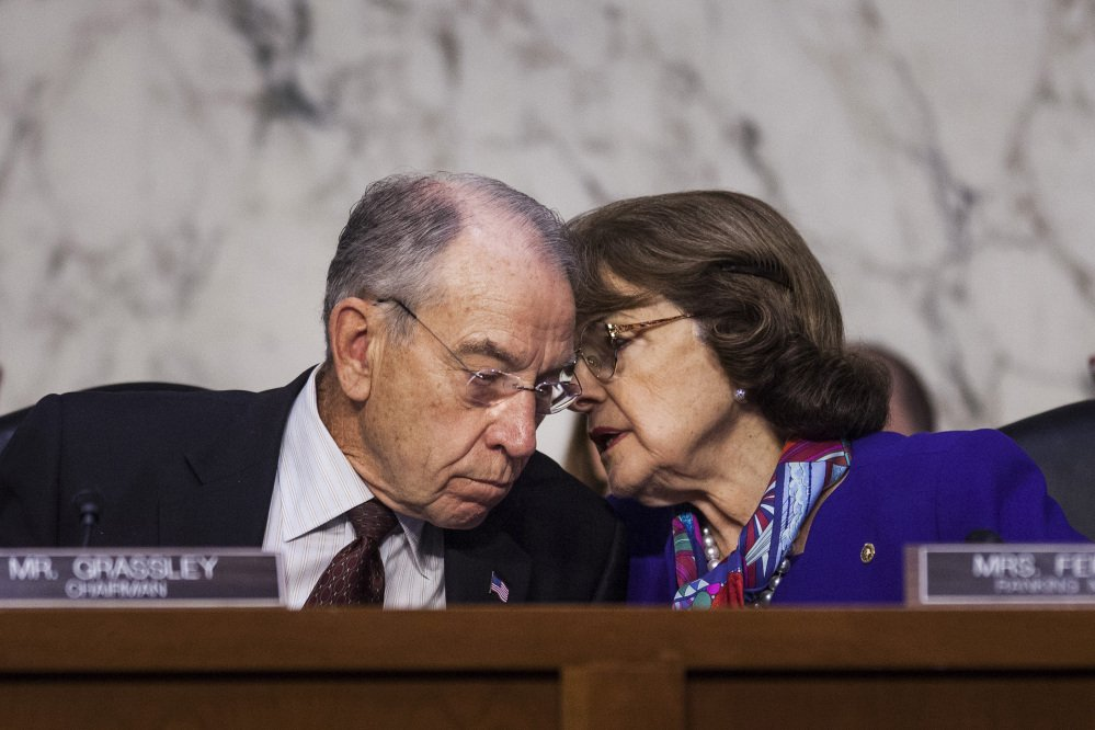 Republican Sen. Chuck Grassley and Democratic Sen. Dianne Feinstein, shown last year, offer different takes on the FBI report about Supreme Court nominee Brett Kavanaugh.