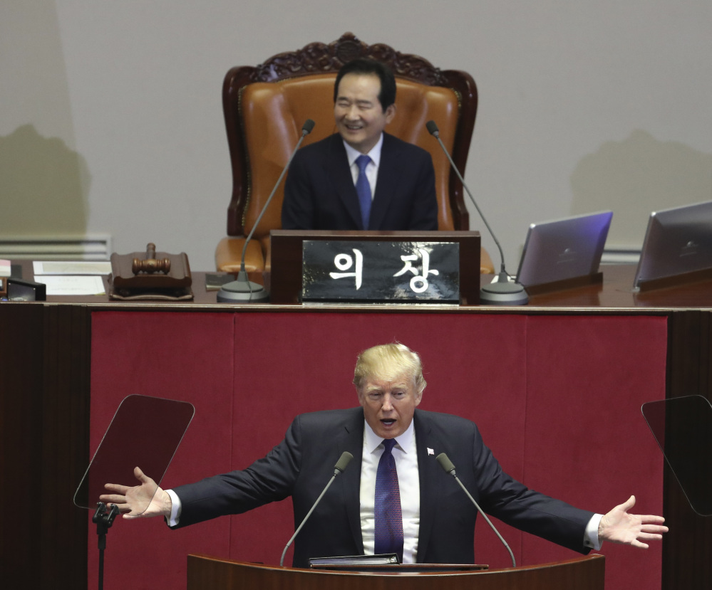 "President Trump delivers a speech as South Korea's National Assembly Speaker Chung Sye-kyun, top, listens at the National Assembly in Seoul, South Korea, Wednesday. Trump told the Assembly that he wants ""peace through strength.""  He said that the U.S. is rebuilding its military and spending heavily on the newest and finest military equipment. Associated Press Lee Jin-man, Pool"