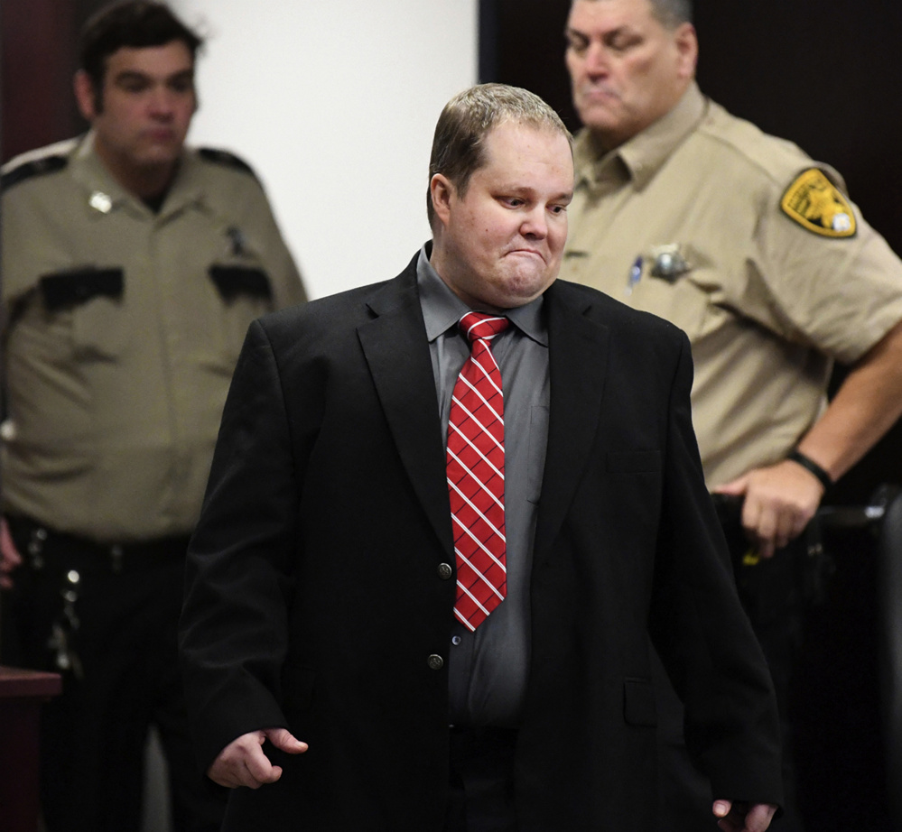 William Hudson walks into court on Nov. 1, the first day of his trial in Bryan, Texas. A jury took only 20 minutes Tuesday to find Hudson guilty of capital murder in the 2015 deaths of six people, including two from Maine. Authorities say William Hudson got angry after learning that two families had cut a lock to a gate to gain access to land they owned for a weekend of camping.