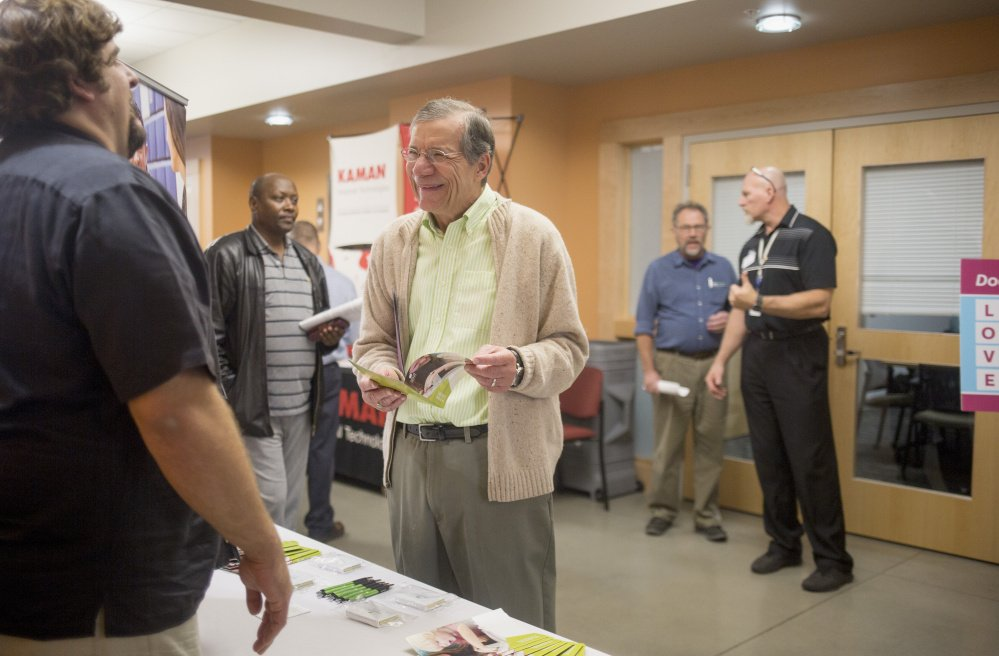 "Michael Parsons, a Vietnam veteran from Scarborough, talks with Chris St. Louis, a recruiter with Spurwink, during a job fair at the Maine Department of Labor office. Parsons only recently started using the services for veterans through the Department of Labor. ""I always thought that those programs were for younger vets,"" Parsons says."