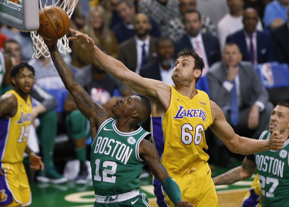 Boston's Terry Rozier goes to the basket past Los Angeles' Andrew Bogut in the first quarter on Wednesday night in Boston.