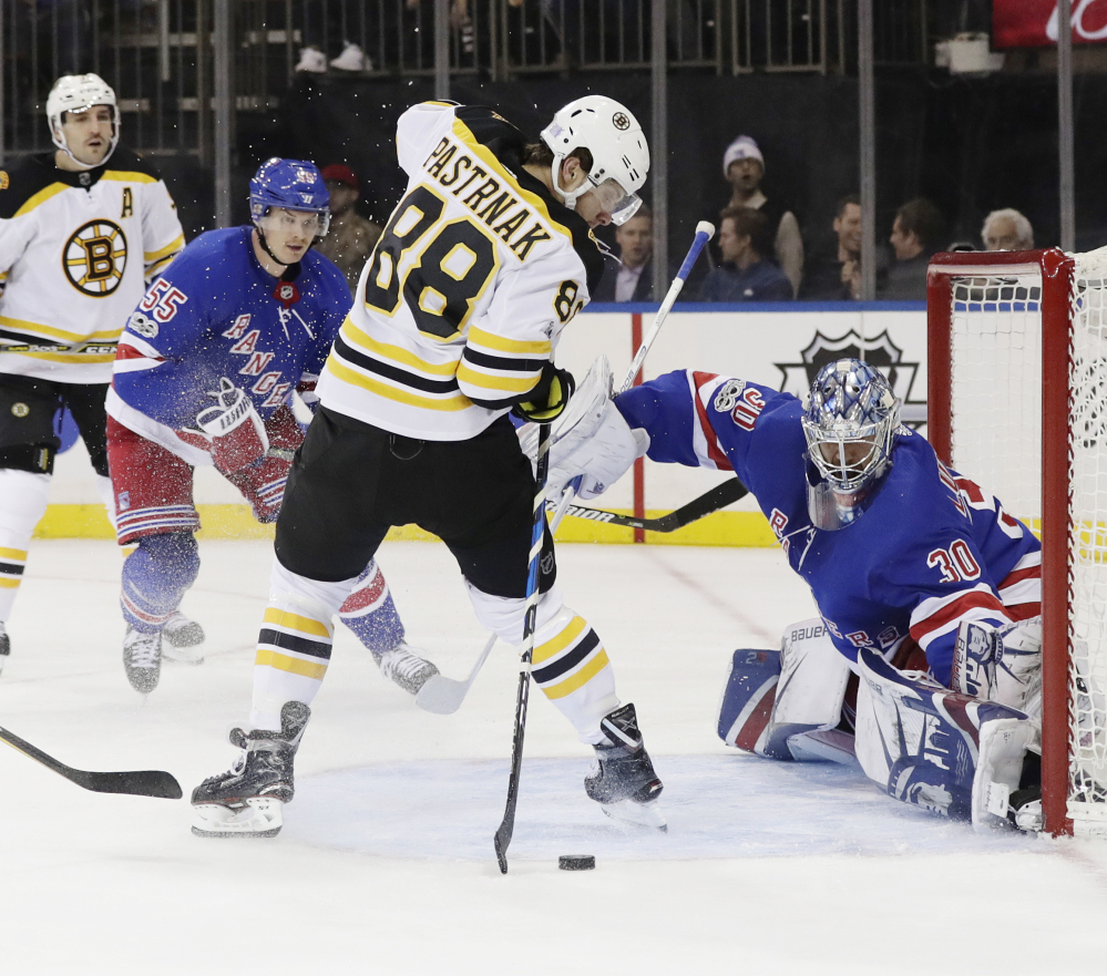Boston's David Pastrnak shoots the puck past Rangers goalie Henrik Lundqvist in the first period Wednesday night in New York.