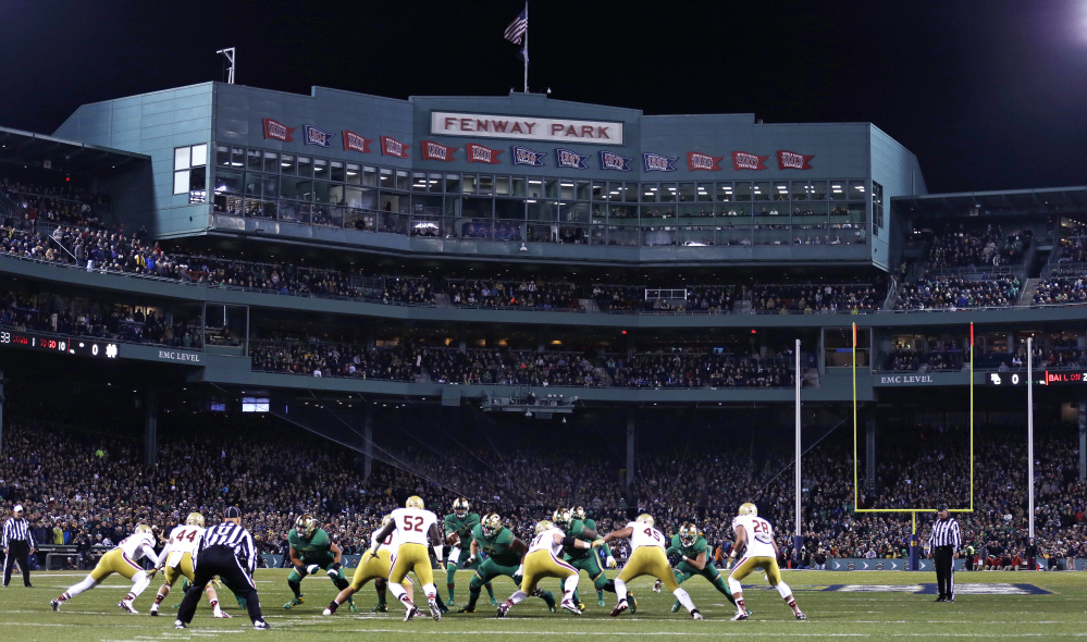 DeShone Kizer, now a quarterback with the Cleveland Browns, takes a snap as the Notre Dame quarterback against Boston College on Nov. 21, 2015 at Fenway Park in Boston, home of the Red Sox. The University of Maine football team takes on UMass on Saturday at Fenway Park.