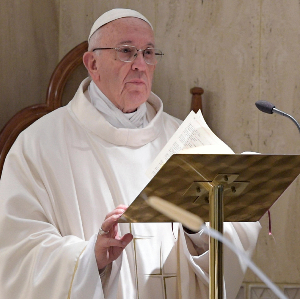Pope Francis celebrates Mass at the Santa Marta Chapel at the Vatican on Friday.